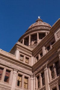 The capitol is famously made of pink granite. A little feminine for Texas, but it is Austin.