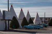 Stay in a wigwam! Although those kind of look like teepees to me...