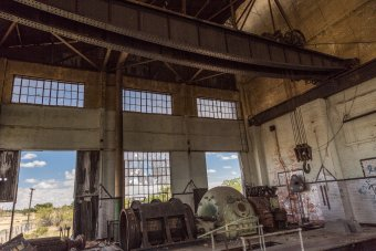 One of the old steam turbines and generators, plus the manually operated overhead crane