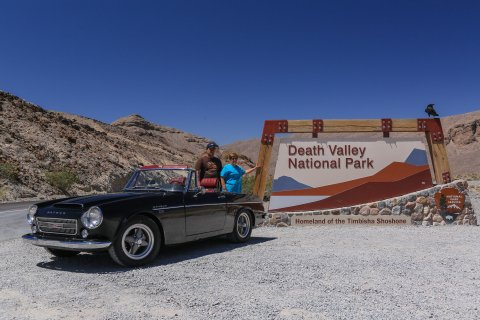 Bob, his mom, and a friend at the entrance to Death Valley