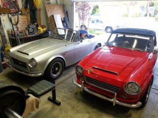 Ted's new car and my old one reposing in my garage