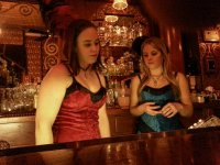 The lovely ladies serving patrons in the saloon