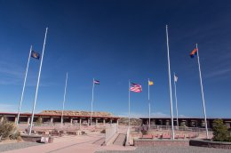 Four Corners, showing the four state flags inside their respective borders, the Navajo Nation flag, and the US flag
