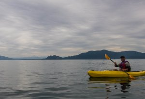 Learning to paddle. Mt. Baker way off in the background