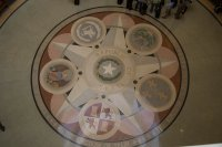 The floor of the rotunda. Texas seal in the middle, seals of everybody else who's ever run Texas all around.