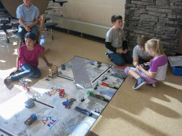 Seth (center), doing a little robot planning